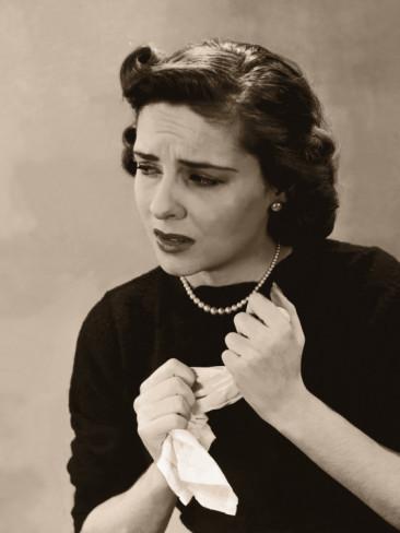 anxious-nervous-woman-wringing-handkerchief-in-her-hands